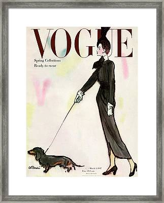 Vogue Cover Featuring A Woman Walking A Dog Framed Print by Rene R. Bouche