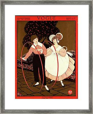 Vogue Cover Featuring Two Children Playing Framed Print by George Wolfe Plank