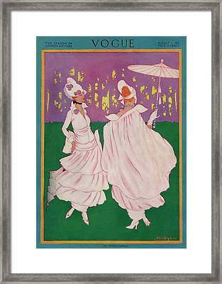 Vogue Cover Featuring Two Women In Pink Gowns Framed Print by Helen Dryden