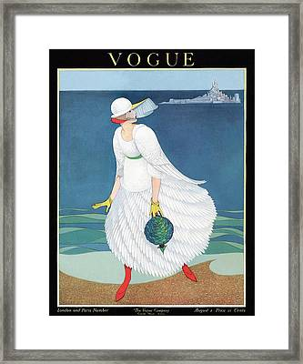 Vogue Cover Featuring Woman At A Beach Framed Print by George Wolfe Plank