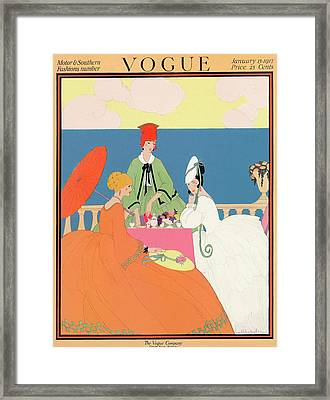 Vogue Cover Featuring Women Dining By The Seaside Framed Print by Helen Dryden