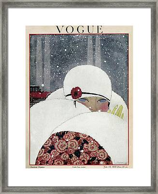 Vogue Cover Illustration Of A Woman Wearing A Fur Framed Print by Georges Lepape