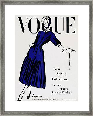 Vogue Cover Illustration Of A Woman Wearing Blue Framed Print by  Dagmar