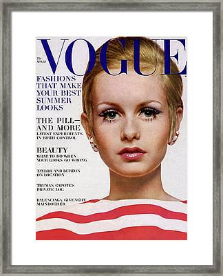 Vogue Cover Of Twiggy Framed Print by Bert Stern