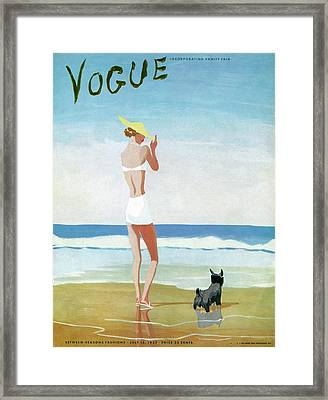 Vogue Magazine Cover Featuring A Woman On A Beach Framed Print by Eduardo Garcia Benito