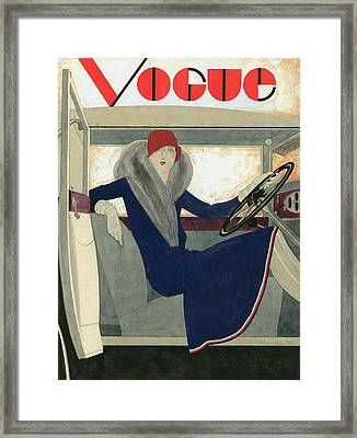 Vogue Magazine Cover Featuring A Woman Sitting Framed Print by Pierre Mourgue