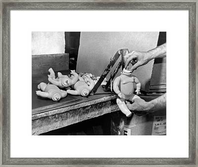 Voicebox Put In A Doll's Neck Framed Print by Underwood Archives