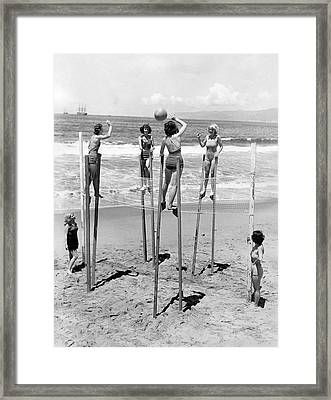 Volleyball On Stilts Framed Print by Underwood Archives