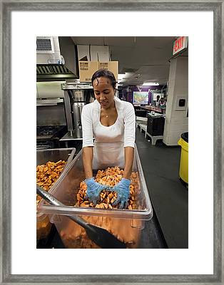 Volunteer At A Community Kitchen Framed Print by Jim West