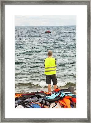 Volunteer Helping Syrian Refugees Framed Print by Ashley Cooper