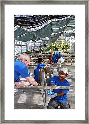 Volunteers At A Botanic Garden Framed Print