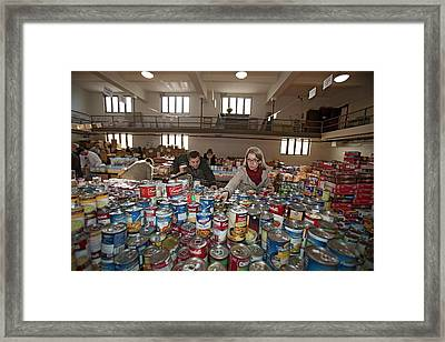 Volunteers At A Food Bank Framed Print by Jim West