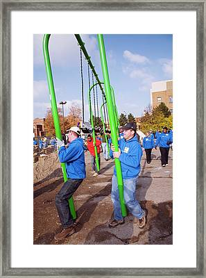Volunteers Constructing A Playground Framed Print by Jim West