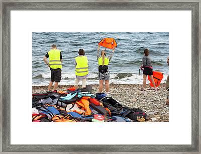 Volunteers Helping Refugees Framed Print by Ashley Cooper