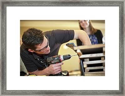 Volunteers Making Bat Houses Framed Print by Jim West
