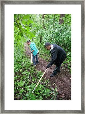 Volunteers Removing Invasive Plants Framed Print by Jim West