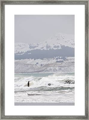 Wading Into Winter Surf Framed Print by Tim Grams