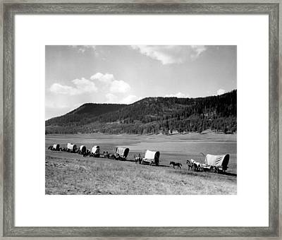 Wagon Train Framed Print by Retro Images Archive