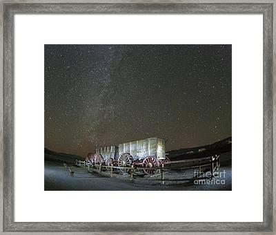 Wagon Train Under Night Sky Framed Print by Juli Scalzi