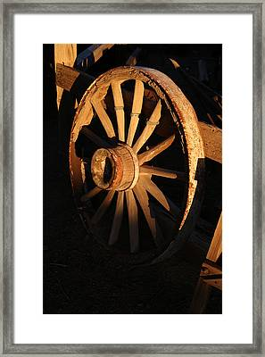 Wagon Wheel At Sundown Framed Print by Michael Hope