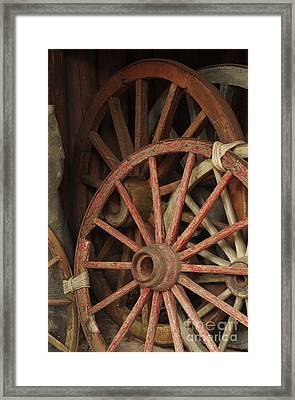 Wagon Wheels Framed Print by Carlos Caetano