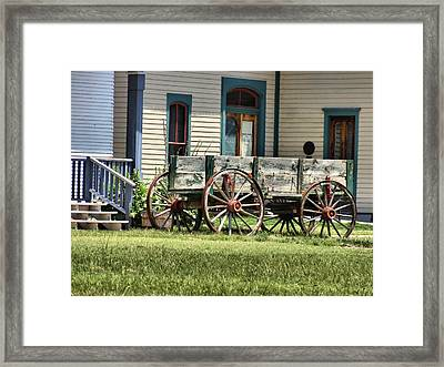 Wagon Wheels In Dodge City Framed Print by Dan Sproul