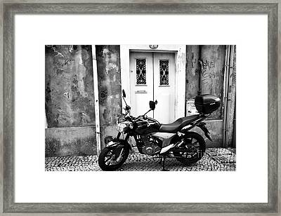 Waiting By The Door Framed Print by John Rizzuto