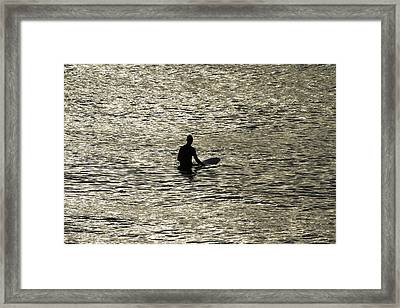 Waiting For An Early Morning Wave Framed Print by Noel Elliot