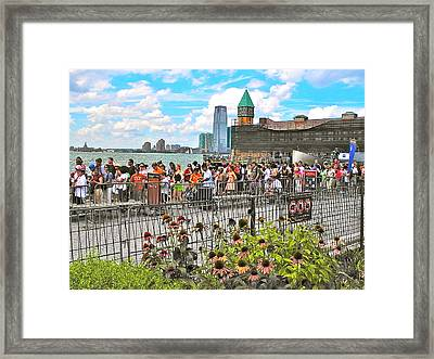 Waiting For The Ferry In Battery Park In New York City-ny Framed Print by Ruth Hager