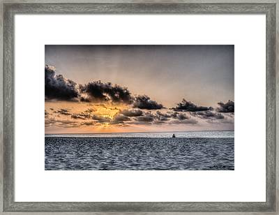 Waiting For The Sun Framed Print by Rodolfo Santibanez