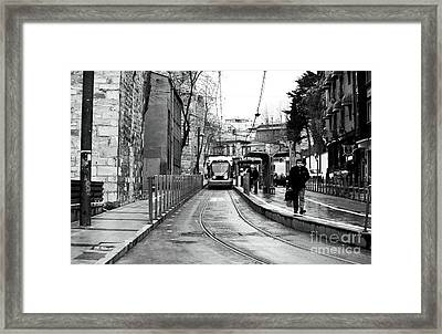 Waiting For The Tram In Istanbul Framed Print by John Rizzuto