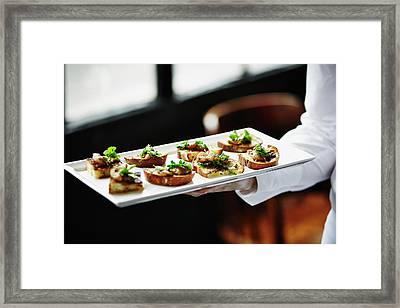 Waitress Holding Platter Of Organic Framed Print by Thomas Barwick