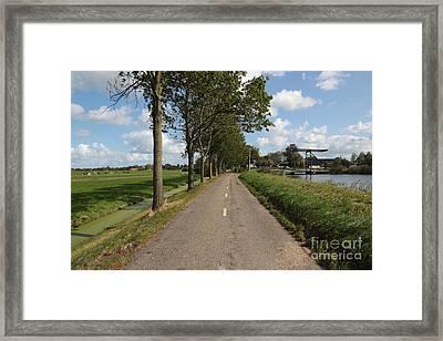 Walk In The Polders Framed Print by Carol Groenen
