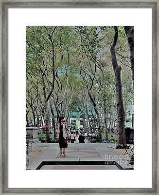 Walk Through Bryant Park Framed Print by C Lythgo
