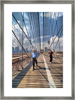 Walkers And Joggers On The Brooklyn Bridge Framed Print