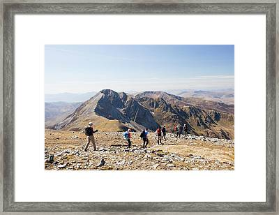 Walkers Descending Mountain Framed Print