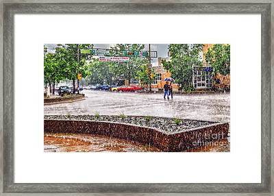 Walking Under The Rain Framed Print by Viktor Birkus