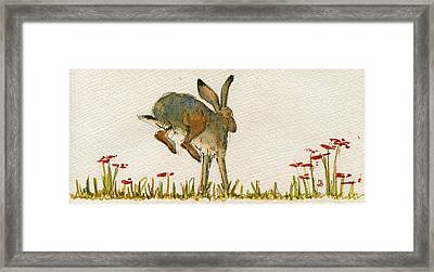 Walking Hare Framed Print by Juan  Bosco