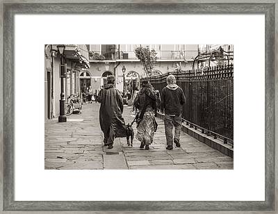 Walking In New Orleans Framed Print by John McGraw