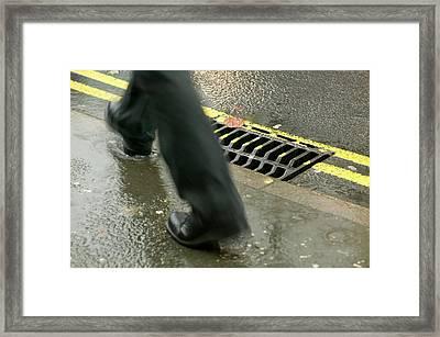 Walking In The Rain Framed Print
