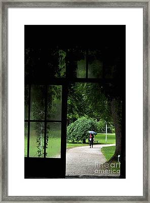 Walking In The Rain Framed Print by Simona Ghidini