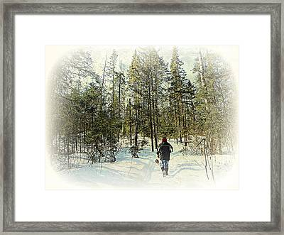 Walking The Dog On A Snowy Trail Framed Print by Dianne  Lacourciere