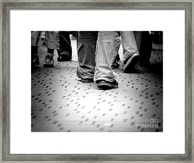 Walking Through The Street Framed Print by Michal Bednarek