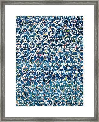 Wall Of Skulls Framed Print