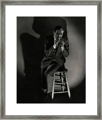Walter Winchell Lighting A Cigarette Framed Print