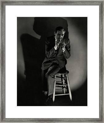 Walter Winchell Lighting A Cigarette Framed Print