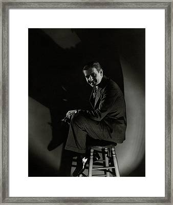 Walter Winchell Sitting On A Stool Framed Print