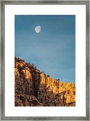 Waning Gibbous Moon Over The Craggy Peaks Of Red Rock Canyon Framed Print by Silvio Ligutti