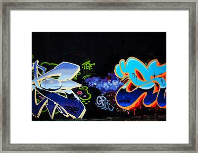 War Of The Wall Framed Print by Karol Livote