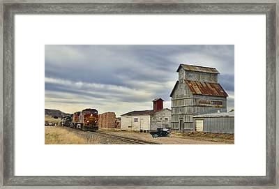 Warbonnet Passing The Grain Elevator Framed Print by Ken Smith